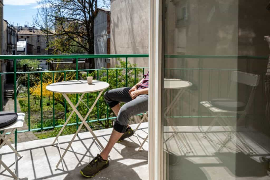 Person sitting on clean balcony.