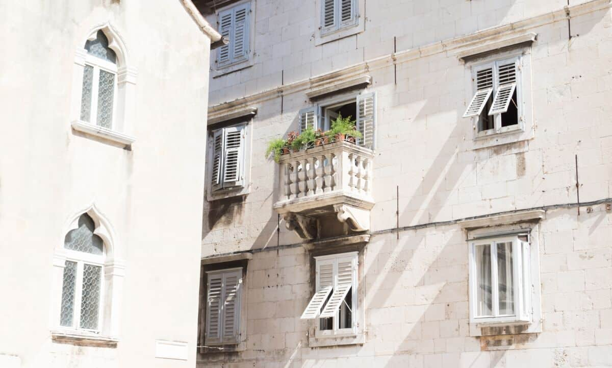 White building with small balcony.
