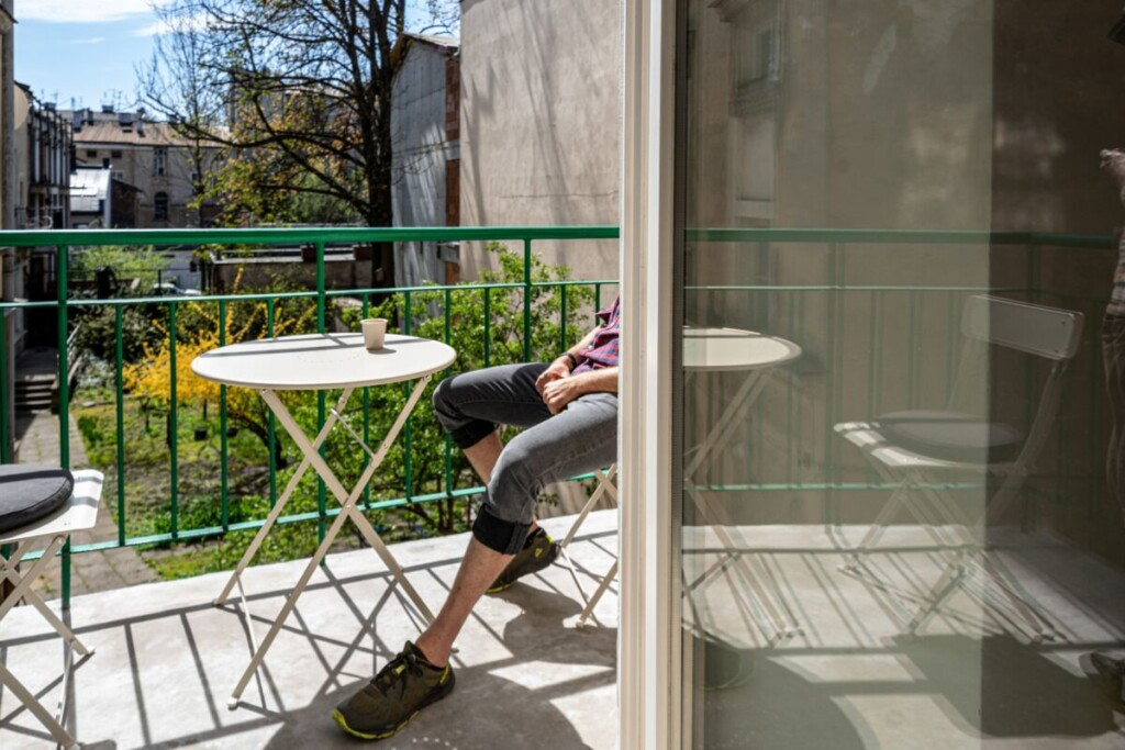 sitting and relaxing on a small balcony