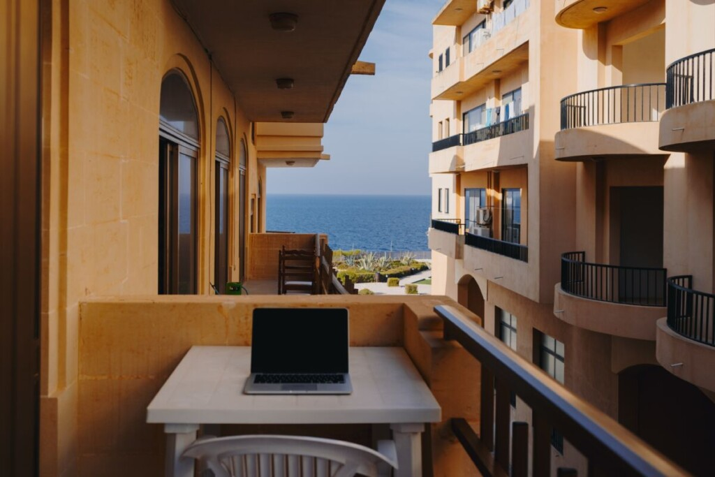 working on a laptop on a balcony
